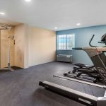 fitness center with cardio machines and weight machine at Clarion Hotel Auburn-Kent-Seattle